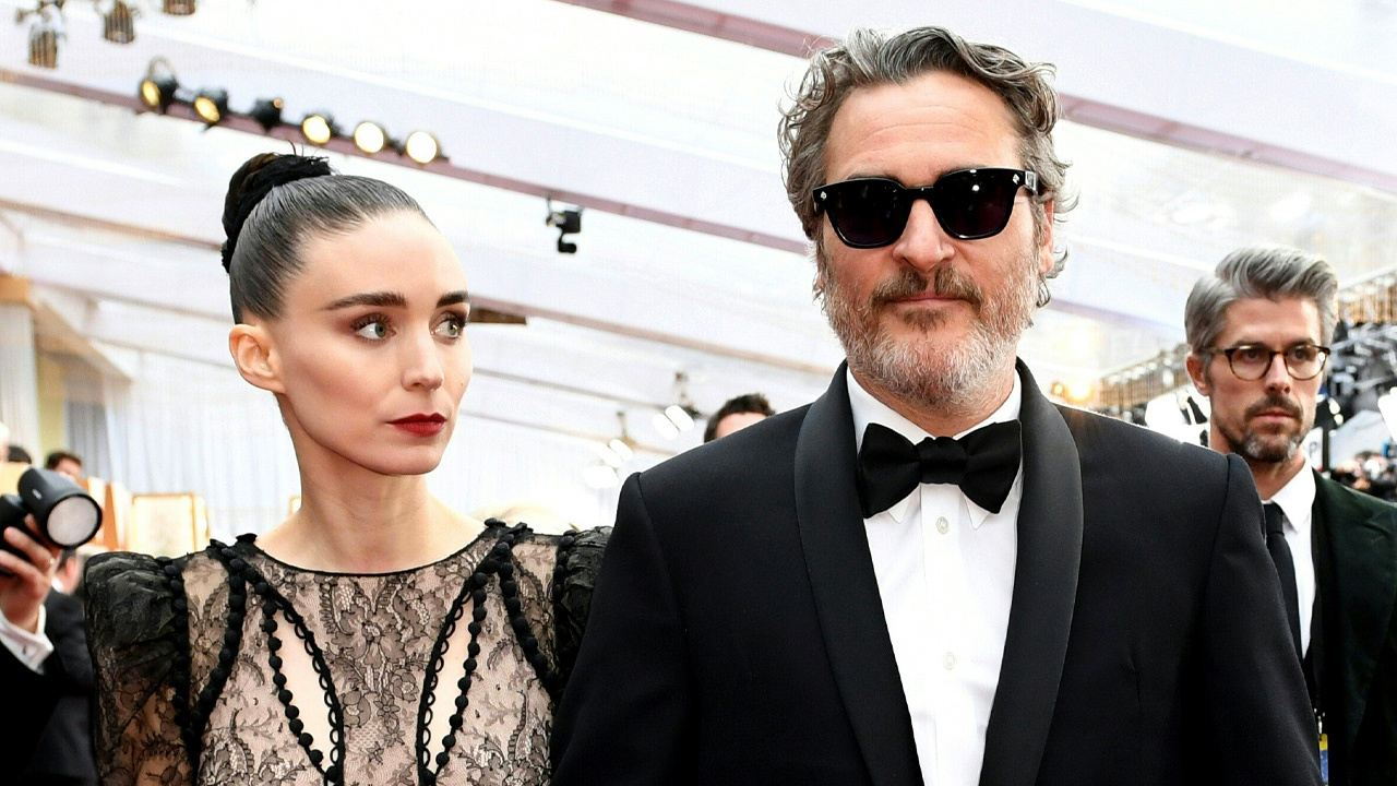 pregnant celebrities 2020: Joaquin Phoenix and Rooney Mara pose on the red carpet
